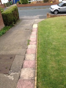 driveway without block paving looking a bit dishevelled